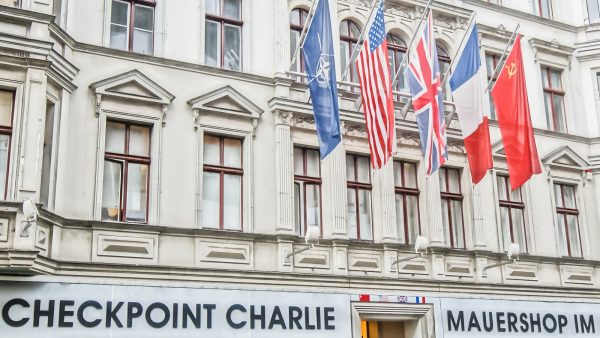 BERLIN, GERMANY - SEPTEMBER 20:   Checkpoint Charlie on September 20, 2013 in Berlin, Germany. It's the best-known Berlin Wall crossing point between East and West Berlin during the Cold War.
